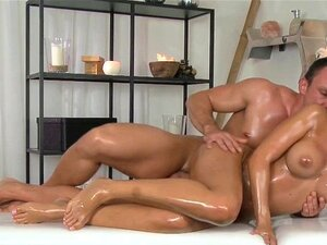 Masseur fucks busty Euro babe in massage room. Masseur rubs a lot of oil to sexy body of brunette with big boobs then she gives him blowjob and he fucks her pussy on a table in massage room