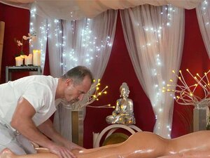 Masseur fucks oiled and big tittied babe. Masseur rubs oil to firm body of sexy brunette babe with huge boobs then shoves his cock into her pussy and fucks her in massage room