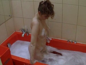 Chick takes a relaxing bath after the work. Every time she comes home from the factory, this gorgeous girl fills the bathtub with hot water and enjoys her time in it She doesnt know anything about the hidden camera, and we hope it will stay that way