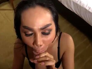 Thai ladyboy in black lingerie riding a bareback cock