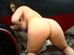Pregnant brunette strips and plays with her heavy tits. Pregnant brunette strips and plays with her heavy tits