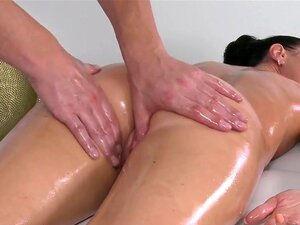 Masseur fucks big booty brunette on a massage table. Masseur rubs and oils sexy tattooed body of brunette babe while laying then fucks her pussy while her big booty bouncing on a massage table