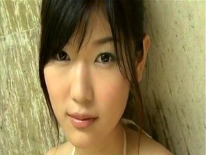 Noriko Kijima in Temptation. This is probably one of Noriko Kijima's most sexy DVD gravure video ever. Lots of sexy footage of Noriko in skimpy bikinis and even one scene where they squirt chocoloate syrup all over her.