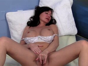 Sweet MILF Leah Masturbating. Gorgeous busty milf Leah masturbating her pussy for orgasm