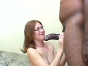 Redhead babe Ginger Blaze sticks a black cock in her mo